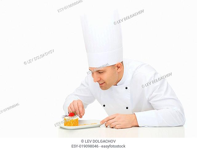 cooking, profession, haute cuisine, food and people concept - happy male chef cook decorating dessert