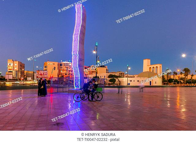 Modern sculpture in town square at sunset in Dakhla, Morocco
