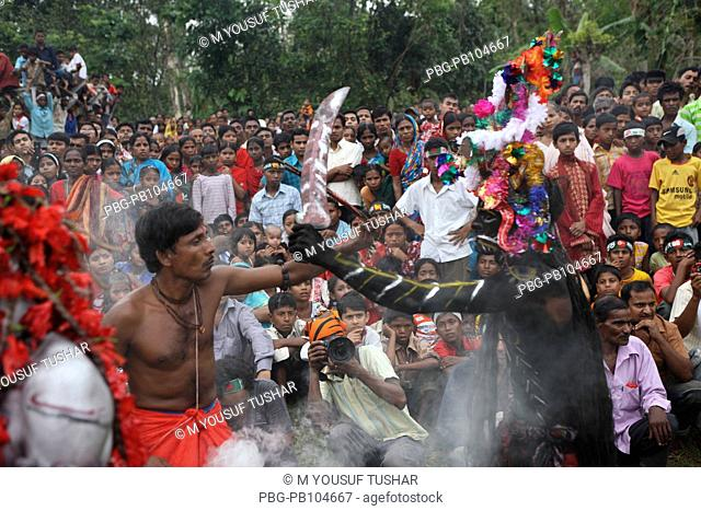 A group of Hindu devotees perform the rituals of Charak Puja It is a very enchanting folk festival of Southern Belt of Bangladesh and West Bengal It is also...