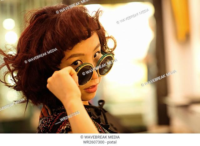 Stylish woman looking over the sunglasses