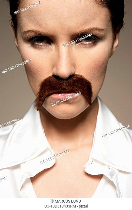 Portrait of woman wearing moustache
