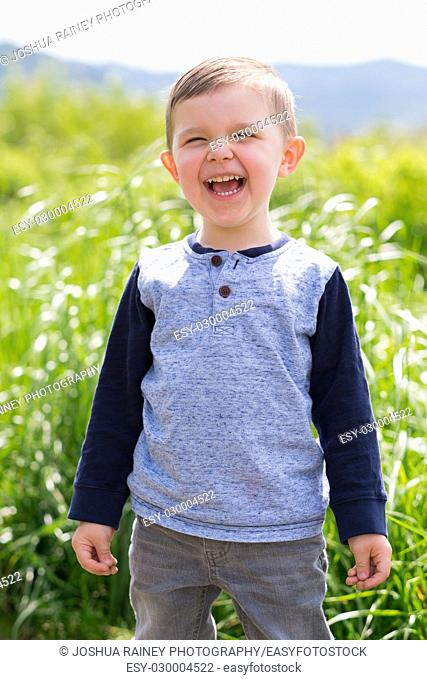 Young boy outdoors in a field in Oregon in this lifestyle portrait