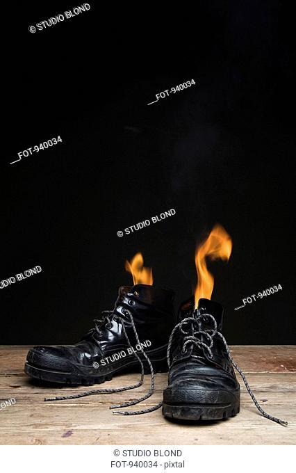 Leather boots on fire