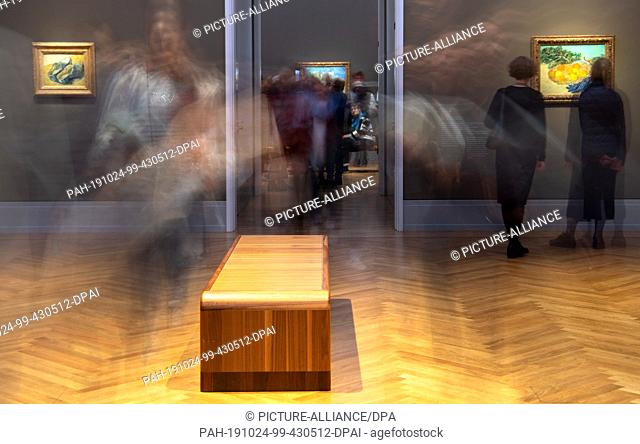 "24 October 2019, Brandenburg, Potsdam: Visitors go after a press conference before opening the exhibition """"Van Gogh. Still life"""" in the Barberini Museum..."