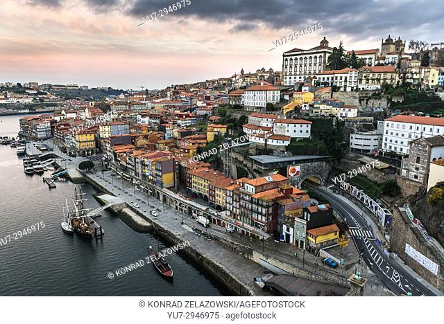 View from Dom Luis I Bridge over Douro River in Porto city, Portugal with building of Bishop's Palace