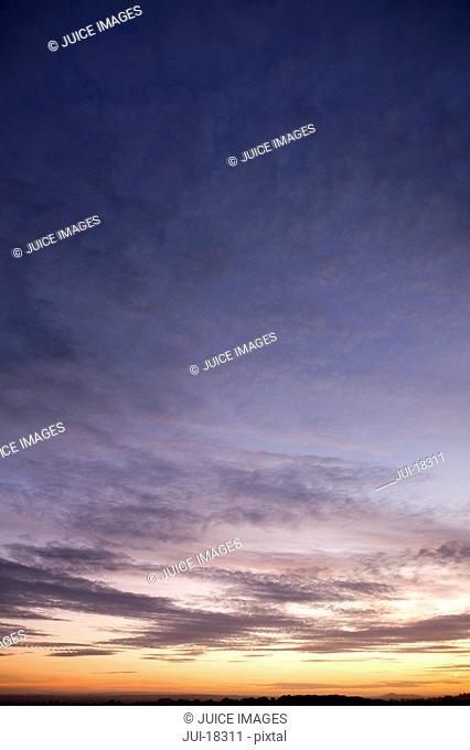 Clouds in sunset sky