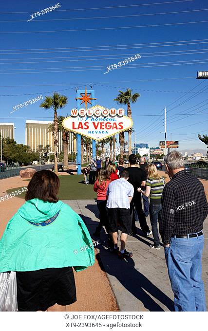 visitors waiting in line to take photos at the welcome to fabulous Las Vegas sign Nevada USA