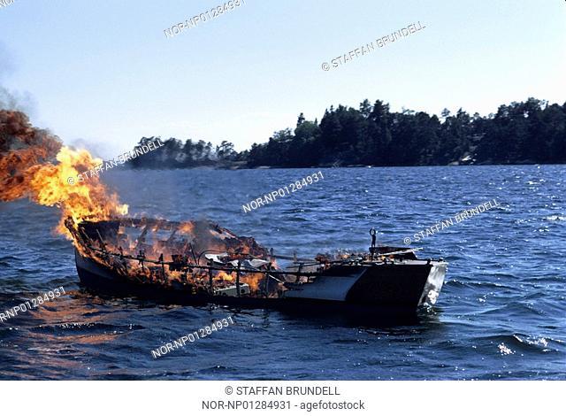 Burning boat in the sea