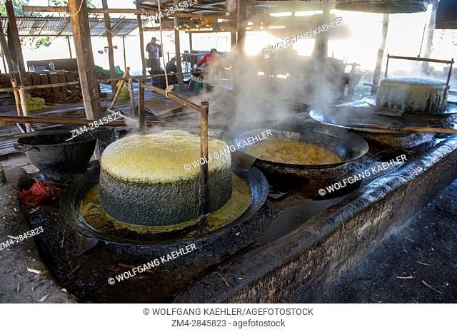 The syrup from sugarcane is being boiled at the factory at Naungtaw Village on Inle Lake in Myanmar