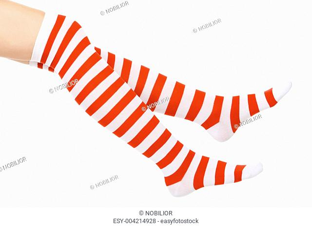 Christmas female legs, isolated on white background