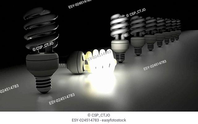 Compact fluorescent lamps in a row. One is lamp is enlightening. Idea Concept