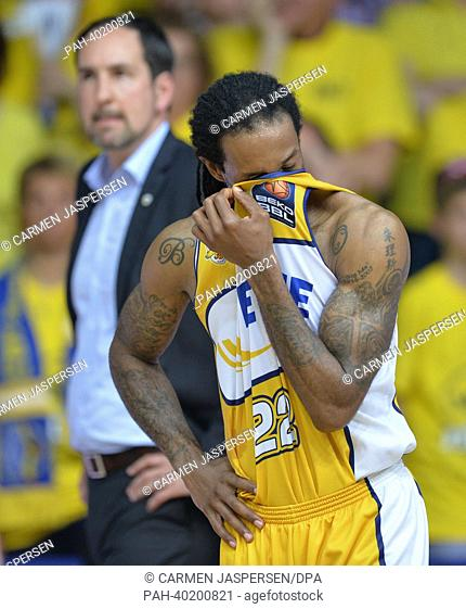 Oldenburg's Julius Jenkins wipes his face, standing in front of head coach Sebastian Machowski after the final match of the Bundesliga Basketball Playoffs (Best...