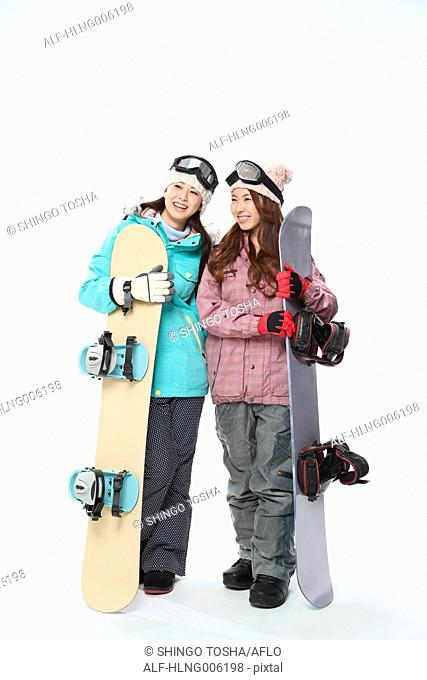 Young Japanese women wearing snowboard wear on white background