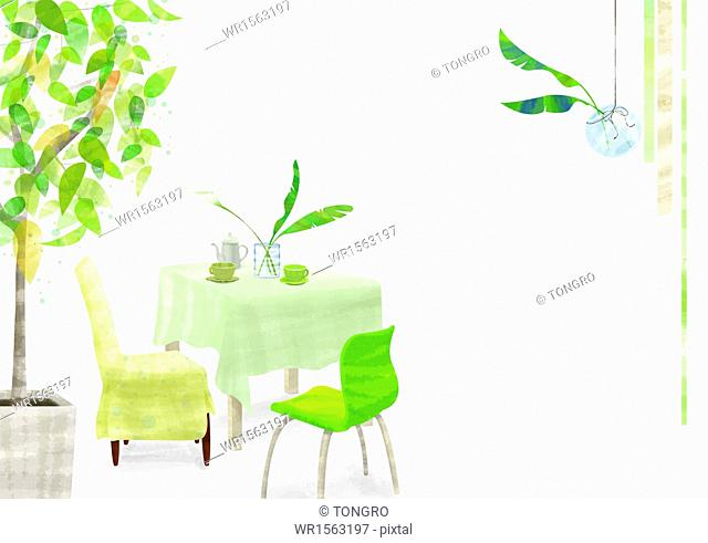 a green chair next to a table