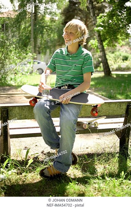 Boy with a skateboard in his knee, Sweden