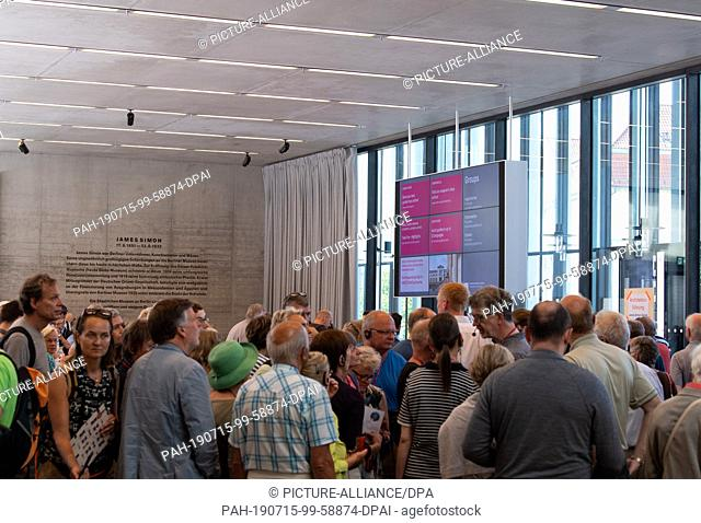 13 July 2019, Berlin: After the opening of the James Simon Gallery, visitors wait for the start of a guided tour. The National Museums have invited to the...