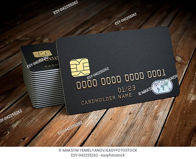Stack of black blank credit cards mockup on wooden table background. 3d illustration