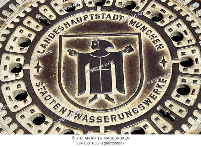 Iron drain cover of the municipal drainage works, waterworks, sewerage, Kindl coat of arms of Munich, Munich, capital, Upper Bavaria, Bavaria, Germany, Europe