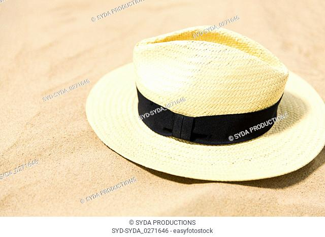 straw hat on beach sand
