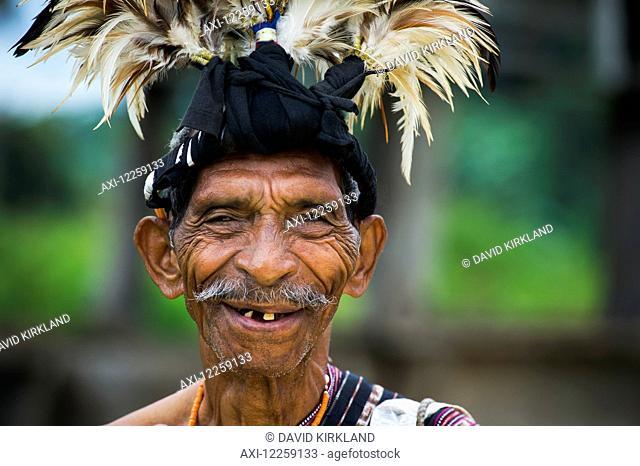 Elderly man in traditional attire; Lospalmos district, Timor-Leste