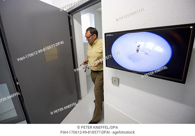 A judicial officer stands in the door of a special video monitored cell at the Deportation Detention Centre in Eichstaett, Germany