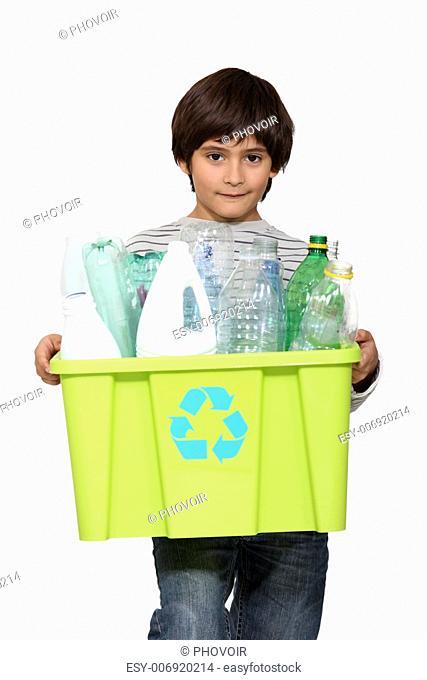 kid holding recycling tub full of empty plastic bottles