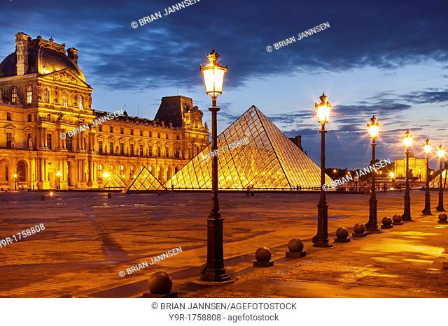 Palais du Louvre at twilight, Paris France