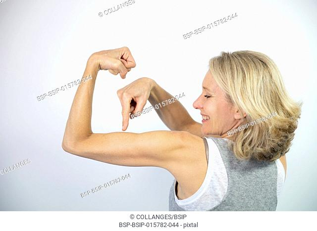 Woman looking at her muscles