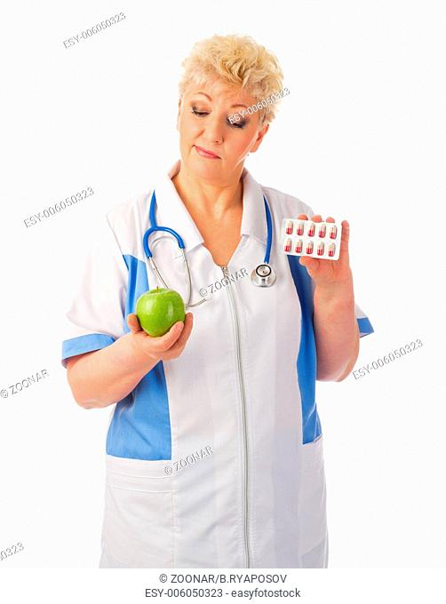 Mature doctor with apple and pills isolated