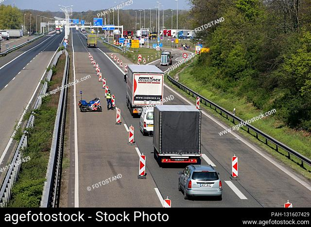Herongen, Germany April 10th, 2020: Symbol pictures - Coronavirus - 04/10/2020 border control Netherlands A61 (Germany) / A74 (Netherlands), traffic control