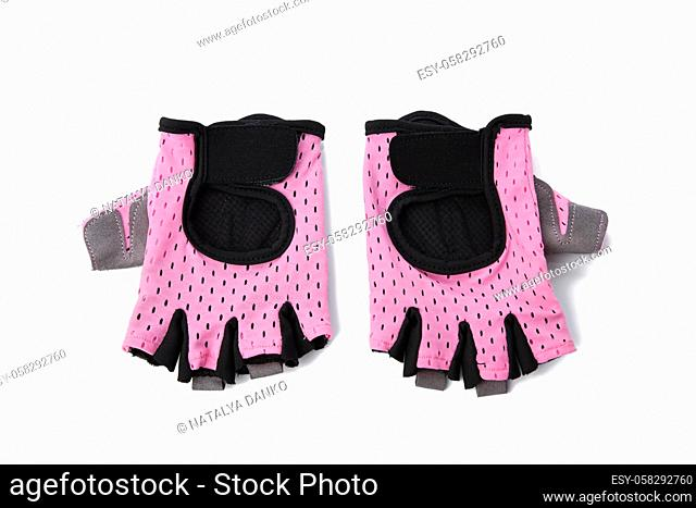 pink textile sports gloves for fitness training and cycling isolated on white background