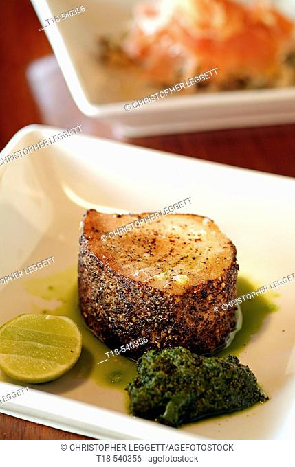 a dish of grilled fish tapas