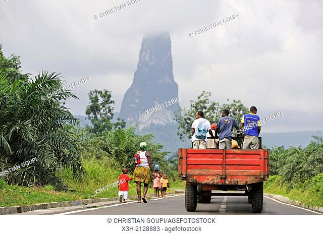 southern road with the Pico Cao Grande Great Dog Peak in the background, southern part of Sao Tome Island, Republic of Sao Tome and Principe, Africa