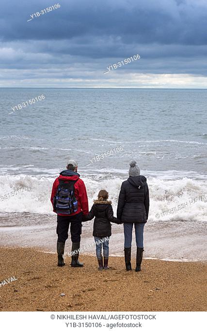 Family on Hive Beach, Burton Bradstock, Dorset, UK