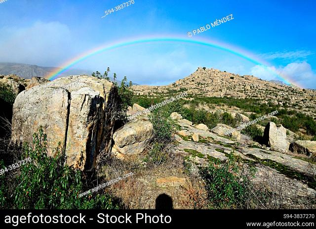 Rainbow in rocky area of Bustarviejo, Madrid, Spain