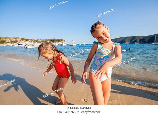 Children playing on the sand beach,Summer travel vacation