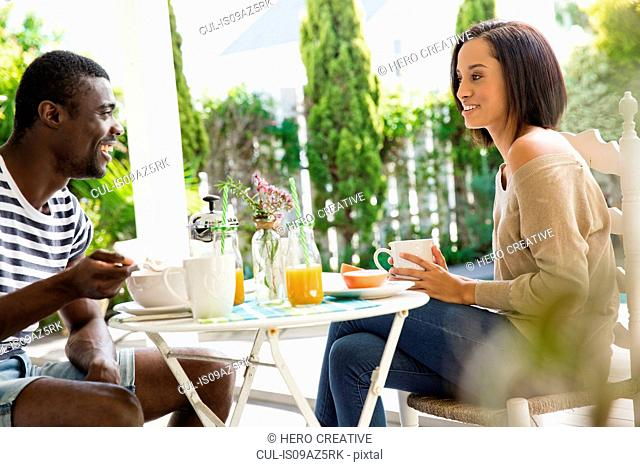 Young couple sharing eating breakfast together