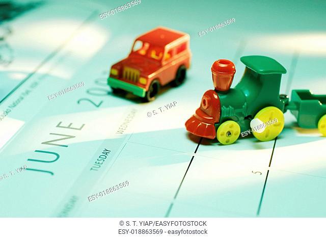 Toy train and car on calendar
