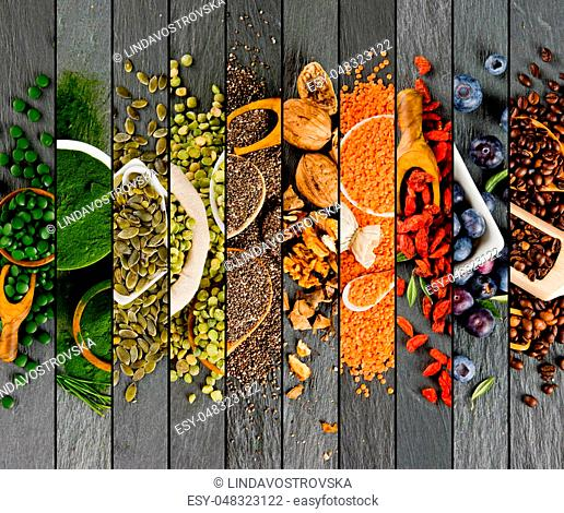 Top view of mixed colorful superfoods scattered on gray slate tile surface