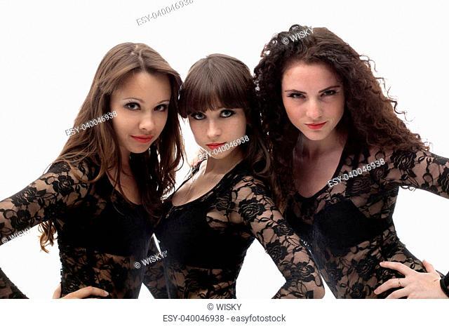 Three seductive young brunettes isolated on white background
