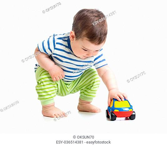 baby boy toddler playing with toy car