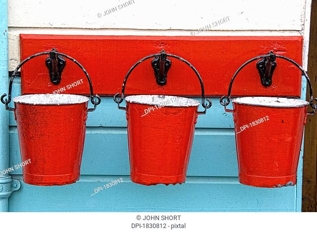 Three red buckets