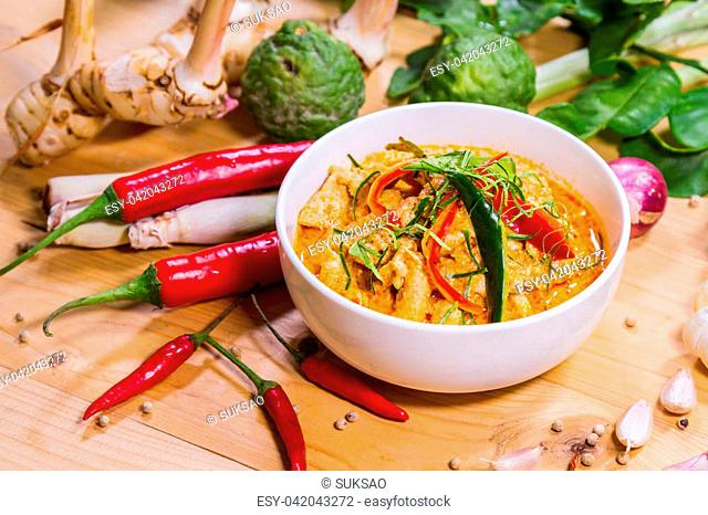 Thailand Food Curry pork spicy on wood table. Thailand call Panang