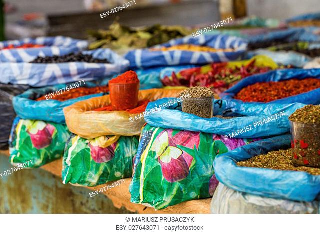 Beautiful vivid oriental market with bags full of various spices in Osh Kyrgyzstan