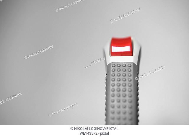 Retro arcade joystick with red button bokeh background