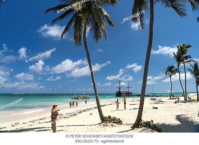 palm fringed sandy beach of Playa Bavaro, Punta Cana, Dominican Republic, Carribean, America,