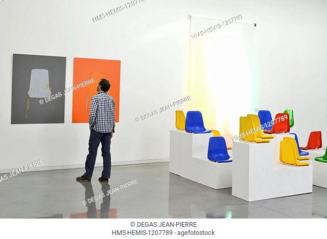 France, Herault, Serignan, Musee Regional d'Art Contemporain (Regional Museum of Contemporary Art), man observing a work in an art gallery
