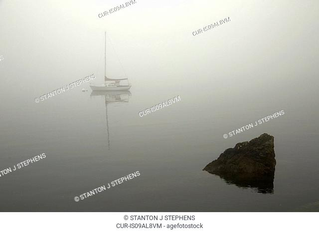 Sailboat on misty lake, Orcas Island, Washington State, USA