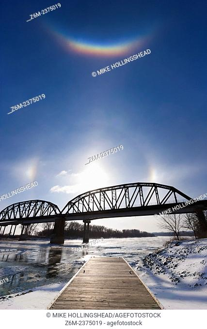 Circumzenithal arc shines brightly above the sun and sun dogs along the Missouri River in eastern Nebraska on a bitter January day