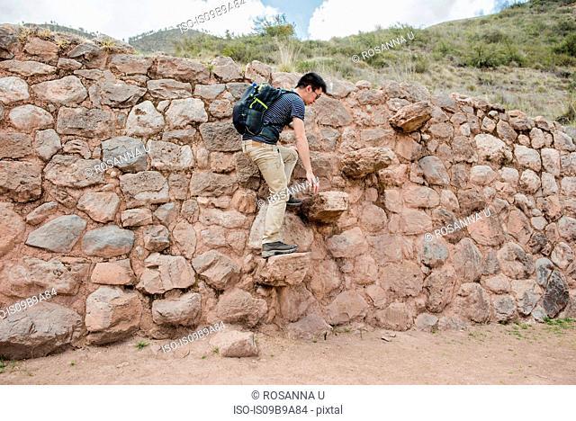 Man exploring Moray Ruins in Maras, Cusco, Peru, South America